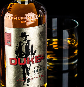 The family of John Wayne are embroiled in a legal battle over their rights to market a new Bourbon brand under the late star's nickname, Duke