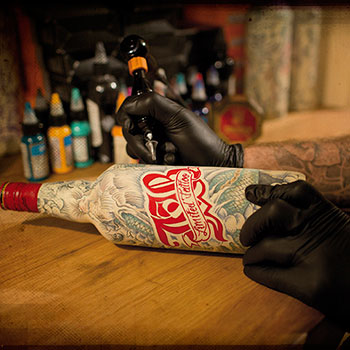 This tattooed bottle of J&B Scotch is one of out top 10 whisky bottle designs
