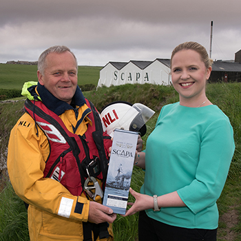 RNLI Lifeboatcrew Graham Campbell and Nicola Stevenson, Scapa Distillery Visitor Manager present Scapa Jutland