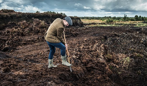 Ged Feltham digs for peat in Ireland