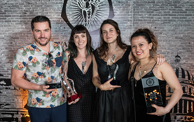 L-r: Stephen Hinz, Kelsey Ramage, Rosie Stimpson, and Laura Angel, accepting award for Carina Soto Velasquez