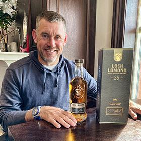 Golfer Lee Westwood with the 25yo Loch Lomond whisky